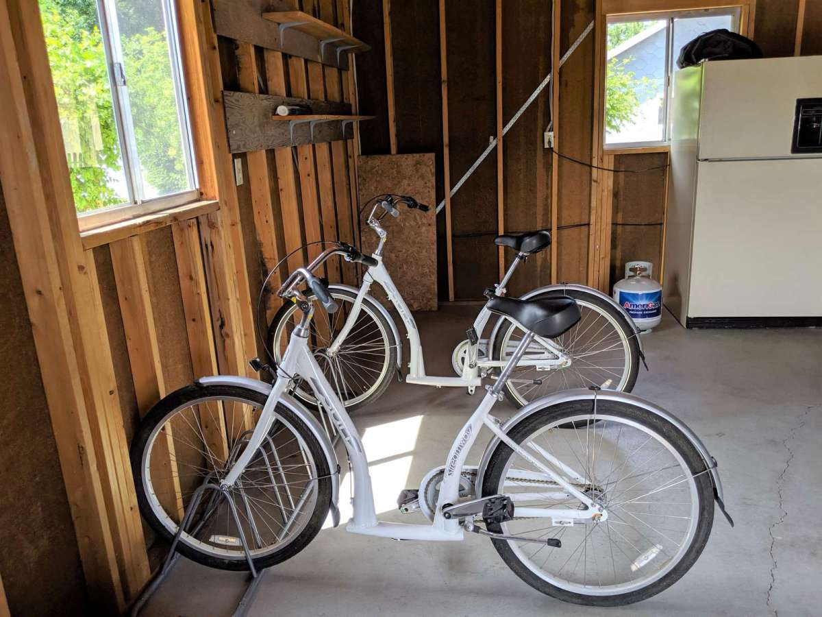 Garage has 2 cruiser bikes and a bike rack