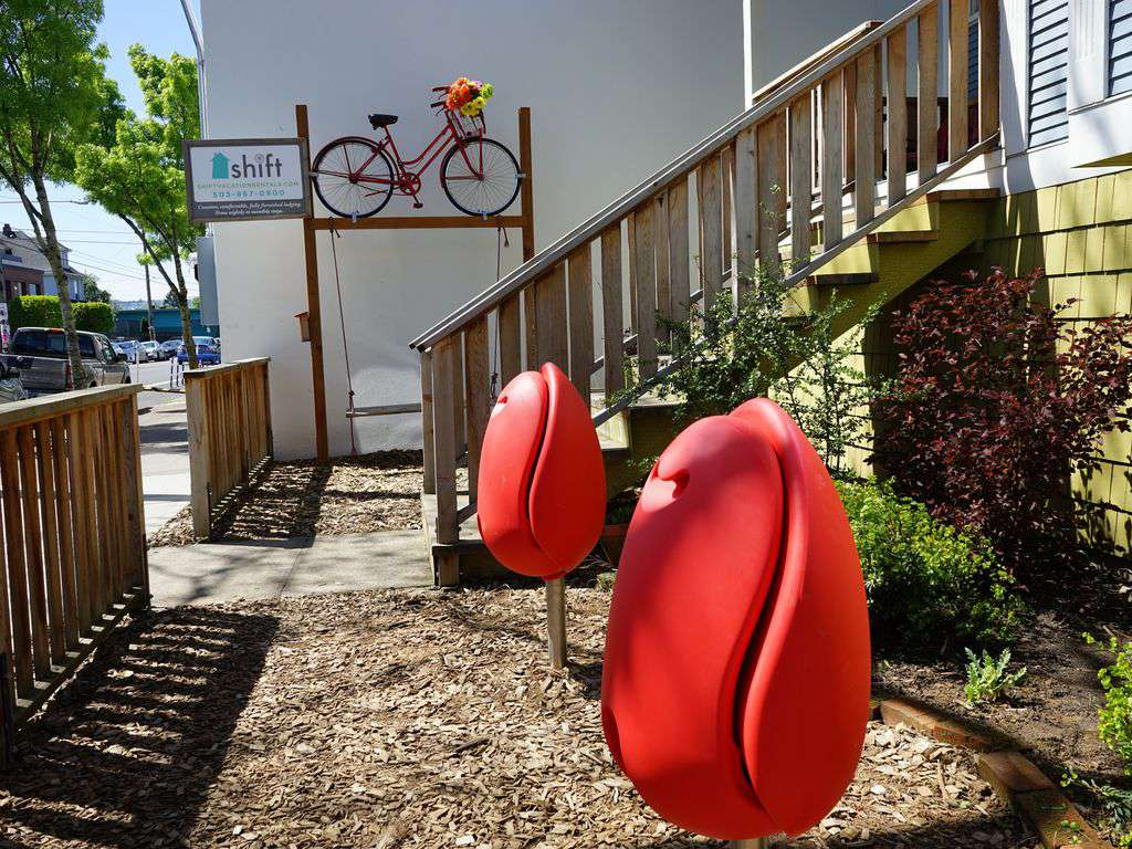Artistic, unique touches, such as these tulip chairs will bring a smile to your face.