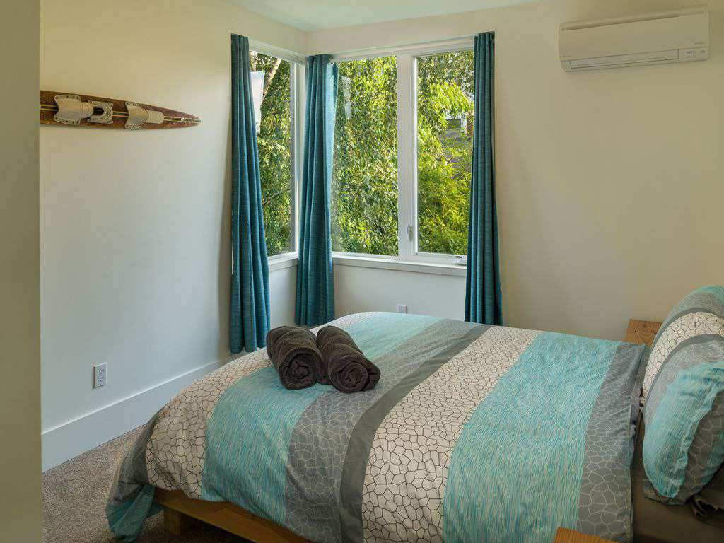On the second floor is 4 more bedrooms. The Beach Room has a queen bed.