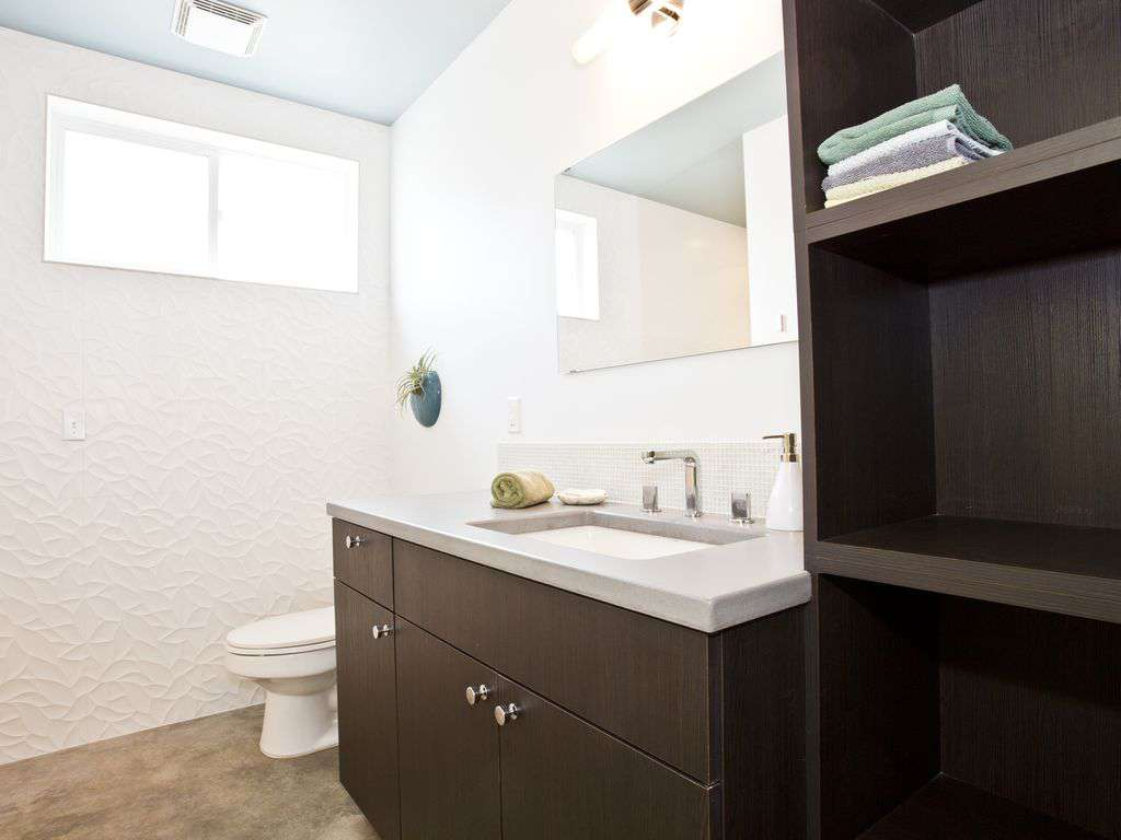 Full bathroom with modern design and touches.