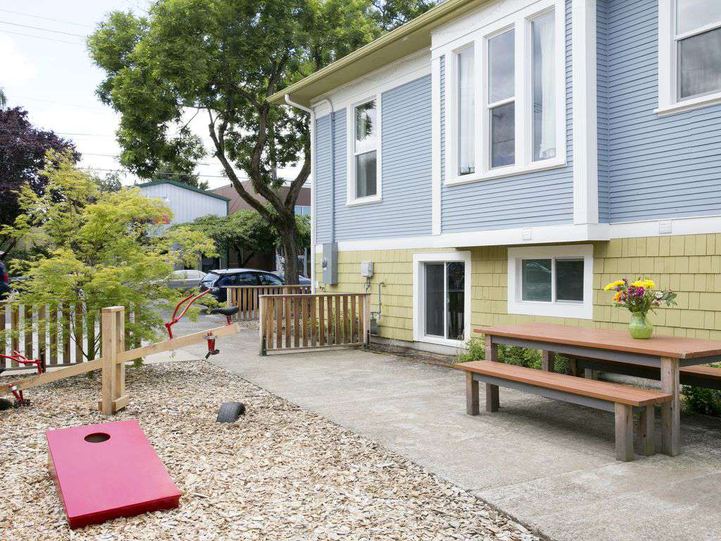 A shared side yard has kids play area & plenty of space to run!