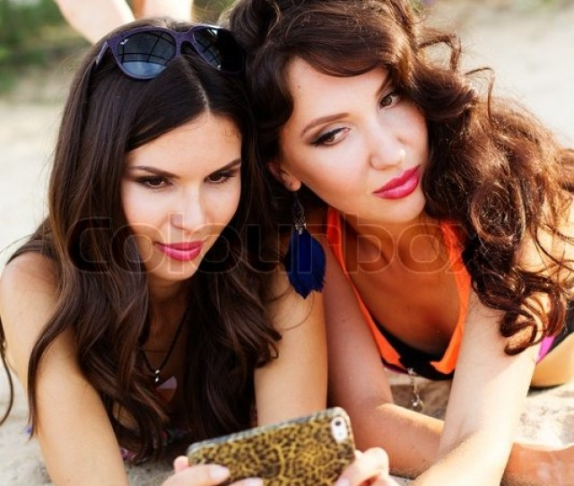 Two Pretty Sexy Girls Friends Are Having Fun Together And Taking Selfe At The Beach Stock Photo Colourbox