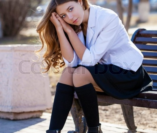Young Beautiful Blonde Schoolgirl Sitting On A Bench Spring Street Stock Photo Colourbox