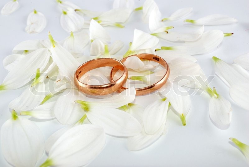 Wedding Rings And Flowers Composition. ...