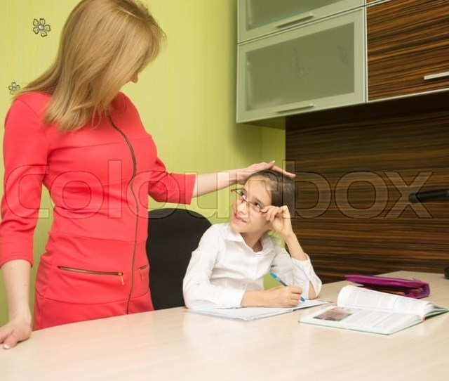 Beautiful School Girl Doing Homework With Sexy Mother At Home Stock Photo Colourbox