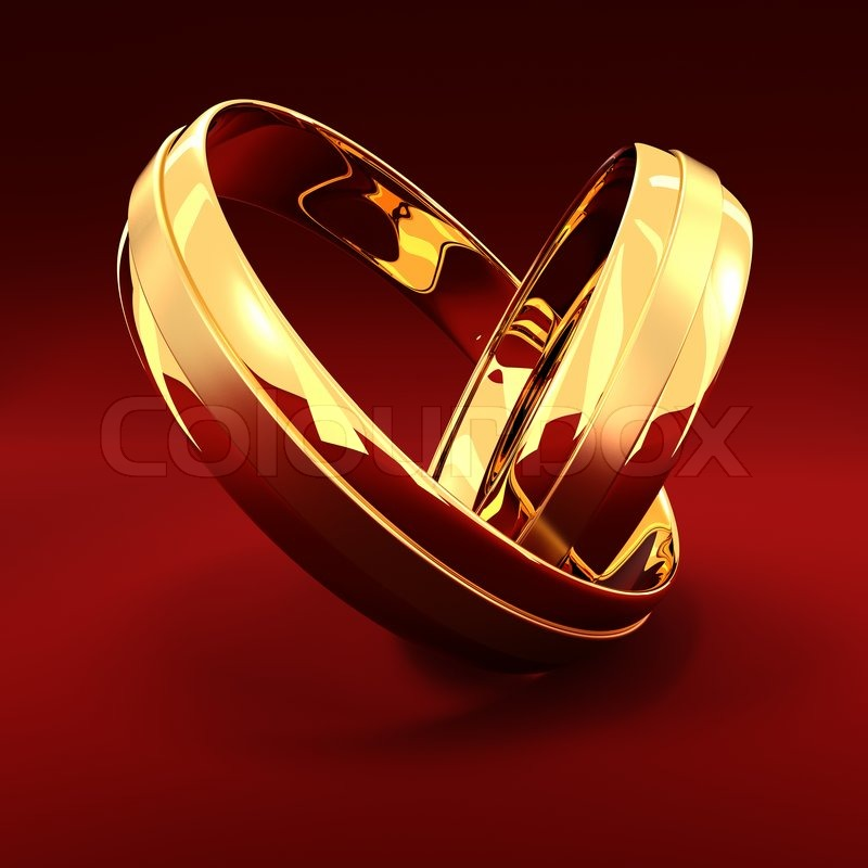 Two Golden Wedding Rings On The Red Background Stock