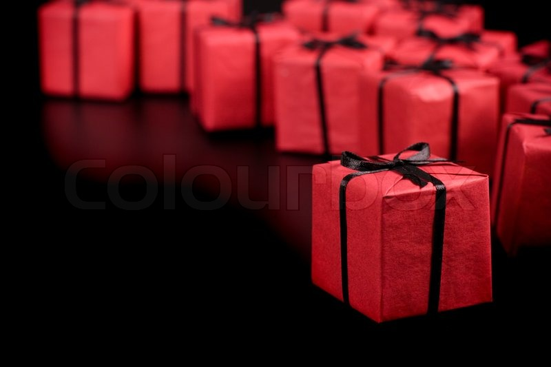 Many Red Gift Boxes On Black Background Stock Photo Colourbox