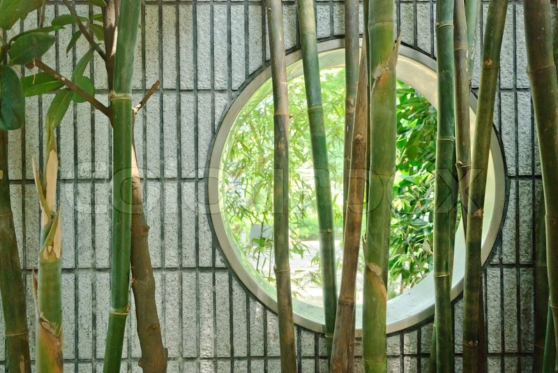 Round Chinese Window In Wall In Garden With Bamboo Stock Photo Colourbox