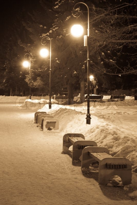 Benches And Street Lights In Winter Park Stock Photo