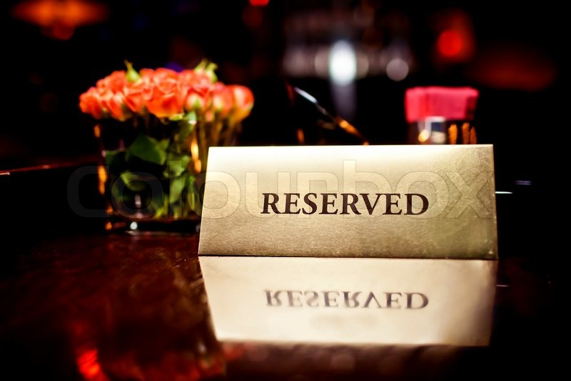 Reserved Sign On The Table In Restaurant Stock Photo