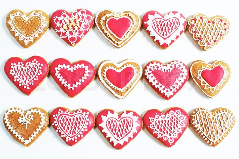 Red Heart Shaped Cookies For Valentines Day Over White