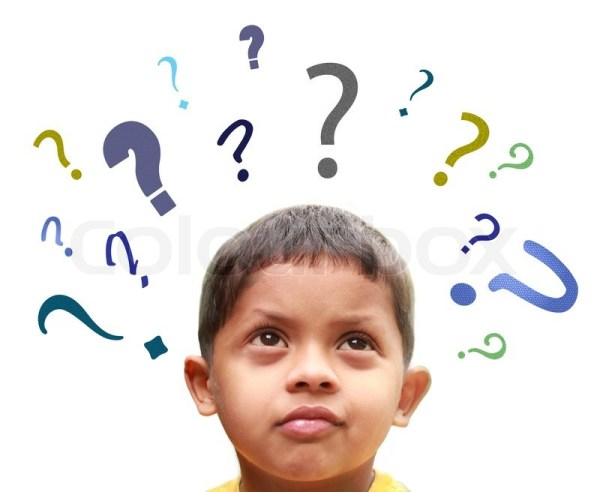 Young indian boy puzzled over many confusing questions ...