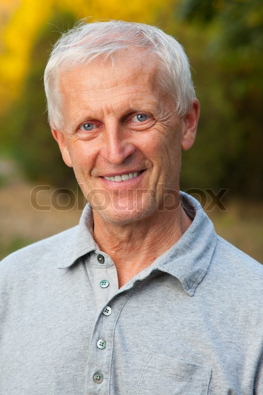 Closeup Portrait Of Happy Face Of Grey Haired Old Man