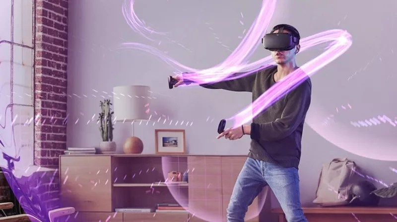 a man with Oculus Quest in a room