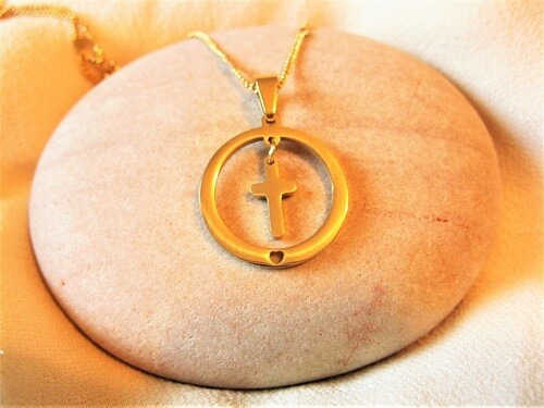 Christian cross in circle necklace for care and guidance