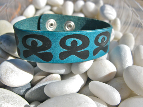 Leather bracelet ~ Indalo dancing, turquoise