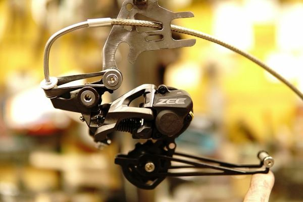 Shimano Zee rear derailleur with modified top link, Diabolo set and chain hook 00024