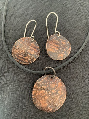 Copper metal n lace jewelry.  Solid sterling silver hand formed wires.  Handmade by René Williams