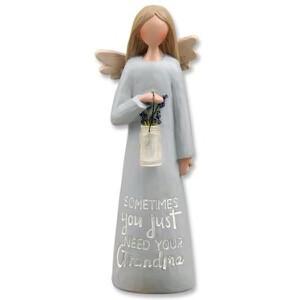 (638) GRANDMA ANGEL W/VASE OF FLOWERS
