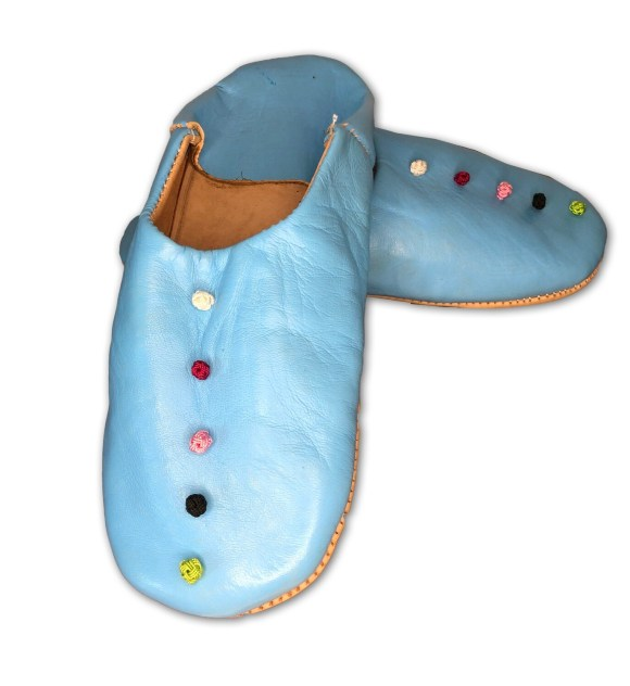 Light blue leather slippers with silk knot decoration