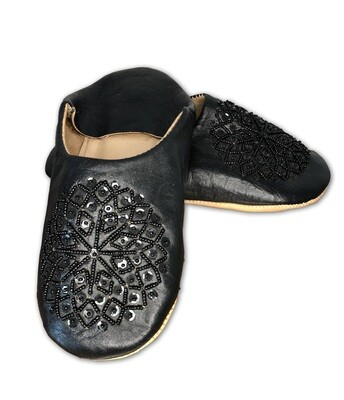 Black leather slippers with sequin decoration