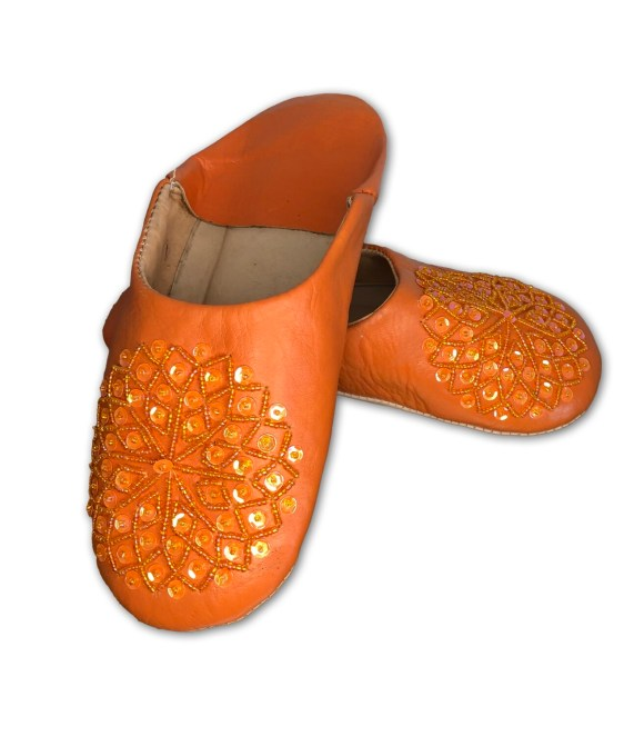 Orange leather slippers with sequin decoration