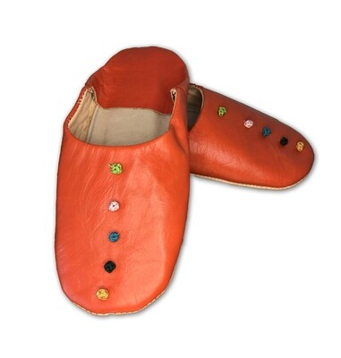 Orange leather slippers with silk knot decoration