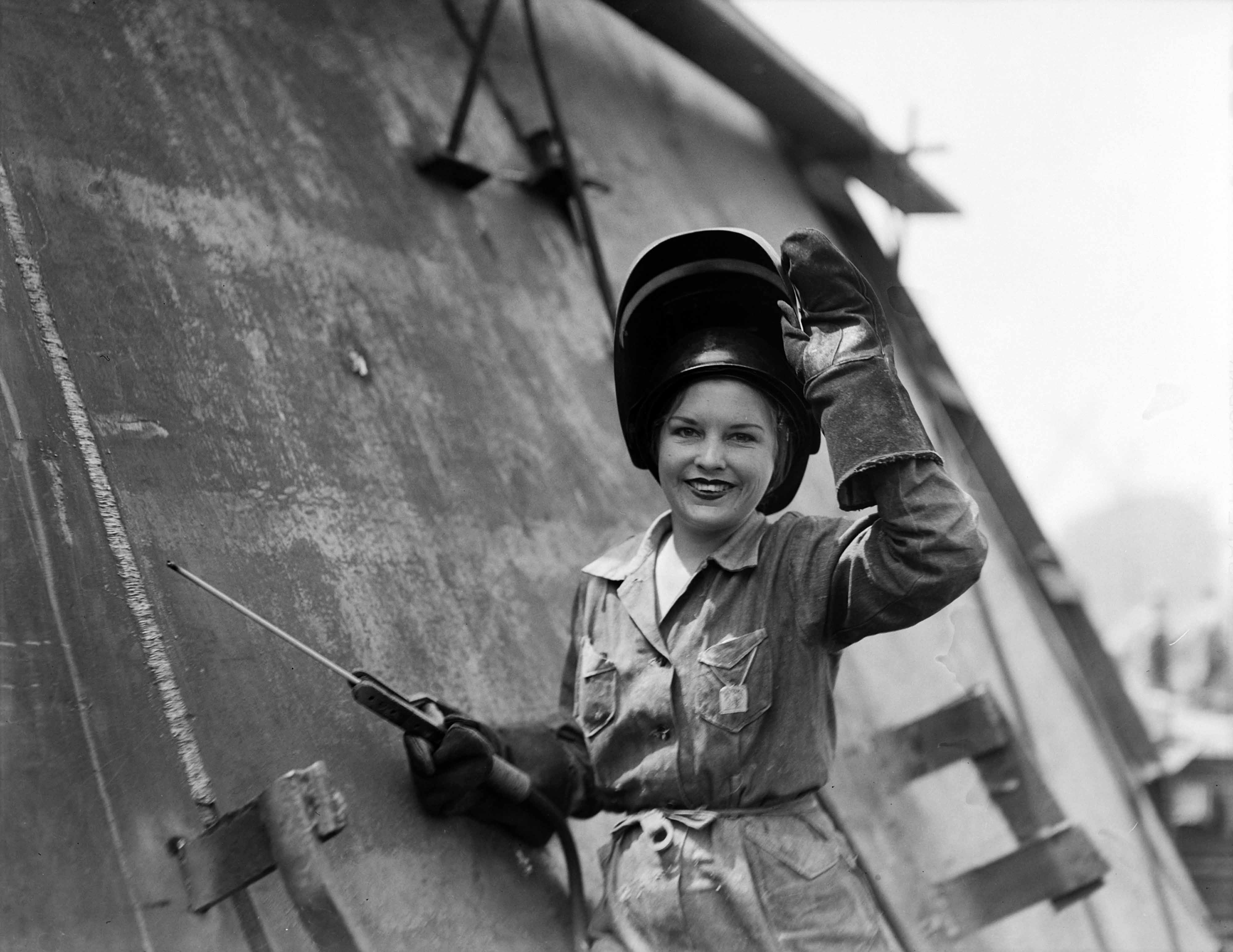 A Photograph Of A Woman Working In The Naval Shipyard In