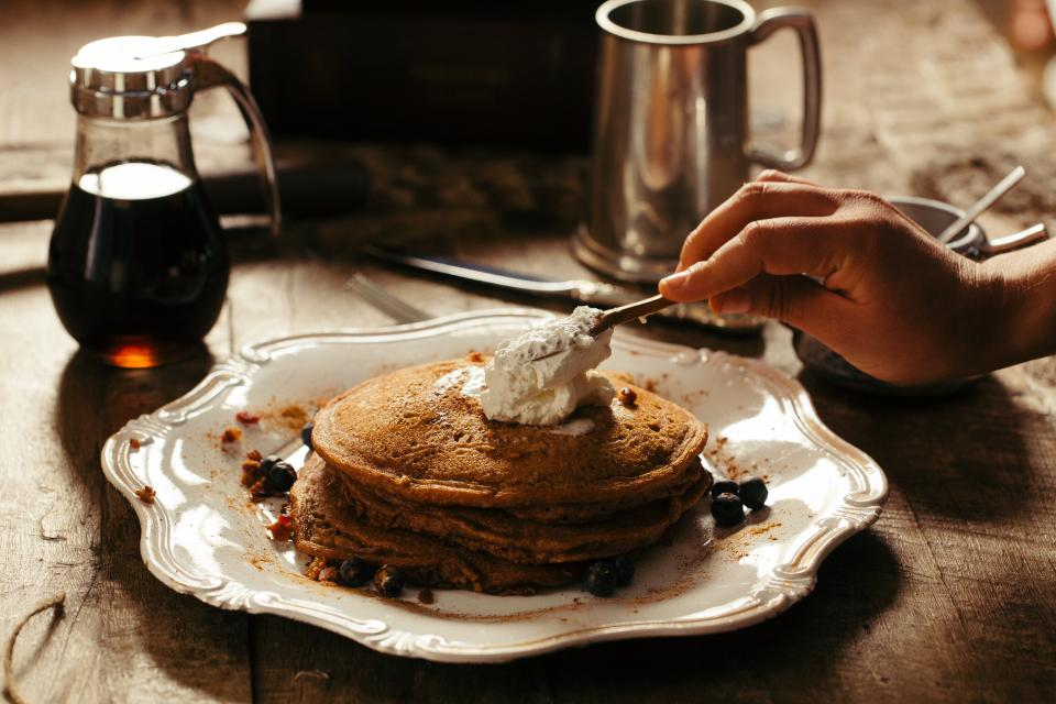food eat breakfast pancakes chocolate whipped cream maple syrup wood table lather still bokeh