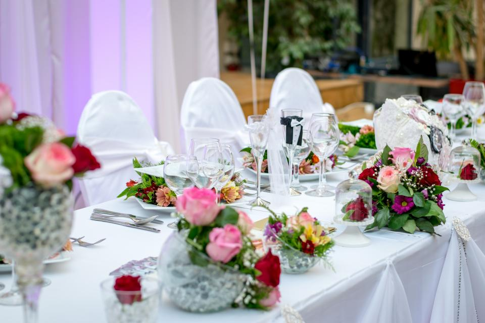 wedding celebration table setup flower cloth skirting design wine glass tableware chairs