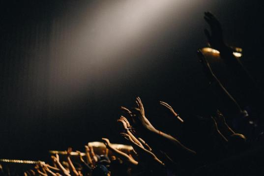 people group event praise worship prayer crowd hands