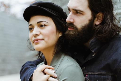 man woman girl guy couple love hug sweet cap beard bokeh blur fashion model outdoor