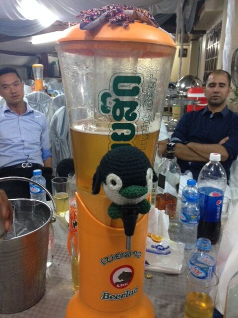 Beer tap featuring Beer Laos with a small plush penguin