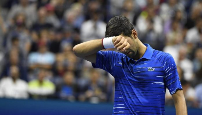 Novak Djokovic wiping his face from PA 752x428 - Tennis Today: Novak Djokovic set for shoulder surgery, and Rafael Nadal credited for new US Open attendance record