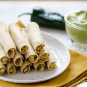 These Mashed Potato and Poblano Flautas from Salud Vegan Mexican Cookbook are golden, crispy, and filled with creamy mashed potatoes and poblano.