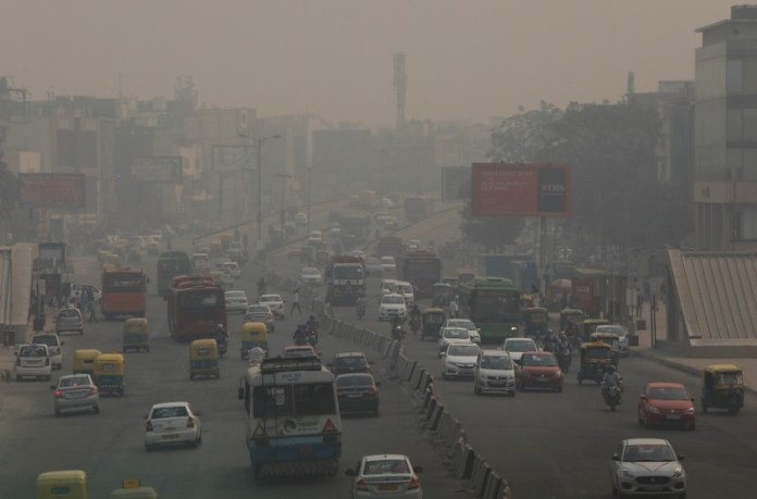Vehicles drive through smog in New Delhi