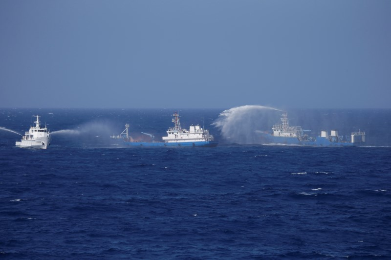 FILE PHOTO: Chinese ships are seen during a search and rescue exercise near Qilian Yu subgroup in the Paracel Islands, which is known in China as Xisha Islands, South China Sea