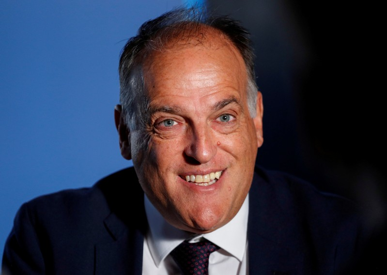 FILE PHOTO: La Liga President Javier Tebas smiles during an interview with Reuters at the La Liga headquarters in Madrid
