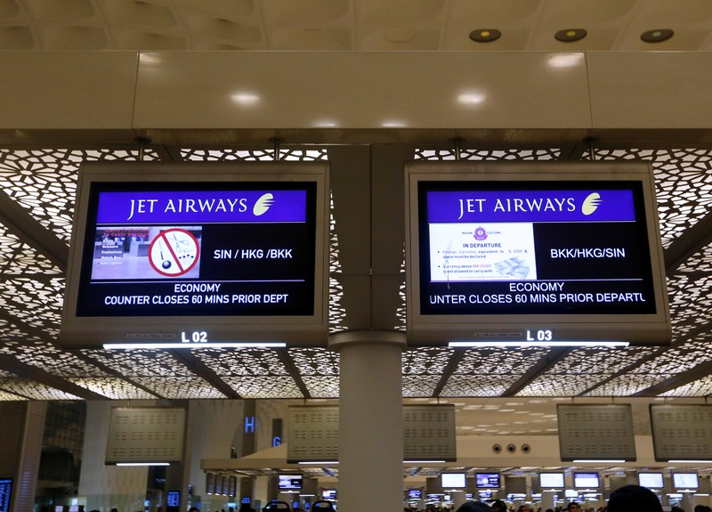 FILE PHOTO: Jet Airways flight information is seen at check-in counters inside the international airport in Mumbai