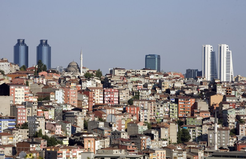 FILE PHOTO: Skyscrapers in the city's business district shape the skyline over Gultepe district in Istanbul