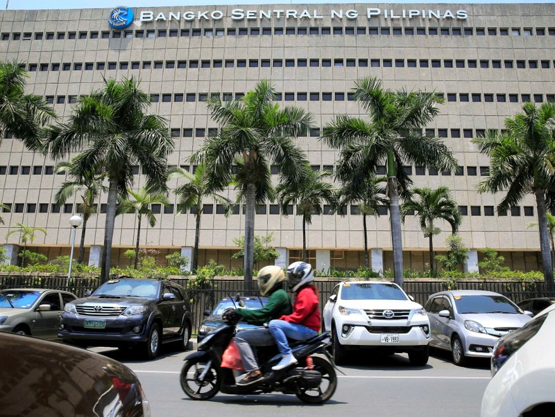 FILE PHOTO: Motorcycle pases a building of the Bangko Sentral ng Pilipinas (Central Bank of the Philippines) in Manila