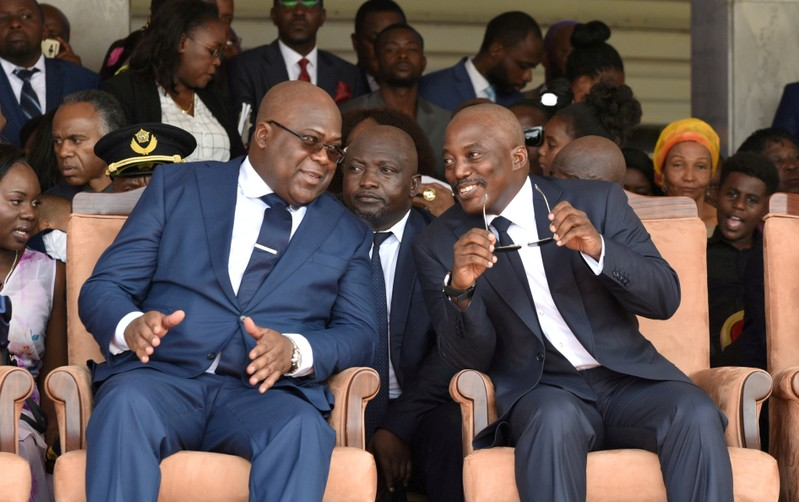 FILE PHOTO: Democratic Republic of Congo's outgoing President Joseph Kabila sits next to his successor Felix Tshisekedi during an inauguration ceremony in Kinshasa