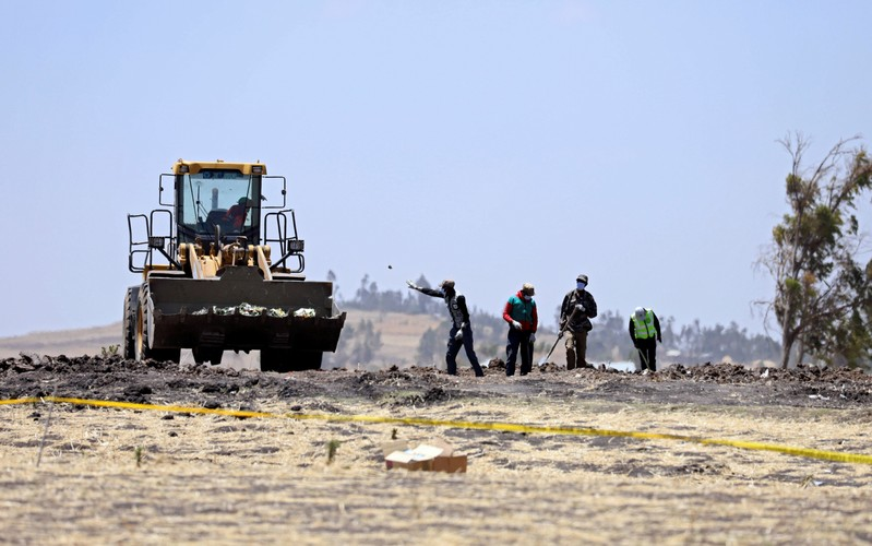 Villagers gather wreckages of the Ethiopian Airlines Flight ET 302 plane crash, near the town Bishoftu