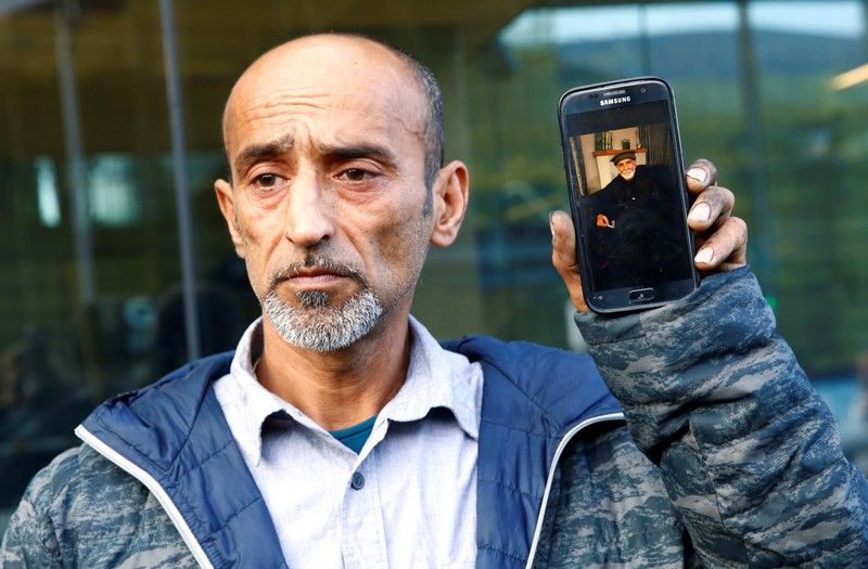 Omar Nabi speaks to the media about losing his father Haji Daoud in the mosque attacks, at the district court in Christchurch