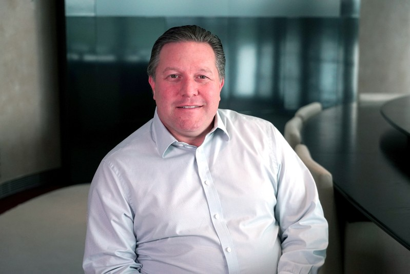 FILE PHOTO: McLaren team principal Zak Brown, poses for a photograph at the McLaren Technology Centre in Woking