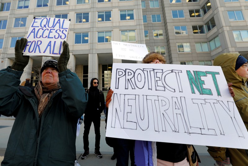 FILE PHOTO: FILE PHOTO: Net neutrality advocates rally in front of the Federal Communications Commission in Washington