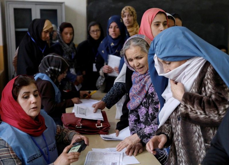 FILE PHOTO: Afghan women line up at a polling station during parliamentary elections in Kabul