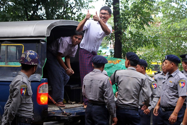 Detained Reuters journalists Wa Lone and Kyaw Soe Oo arrive at Insein court in Yangon