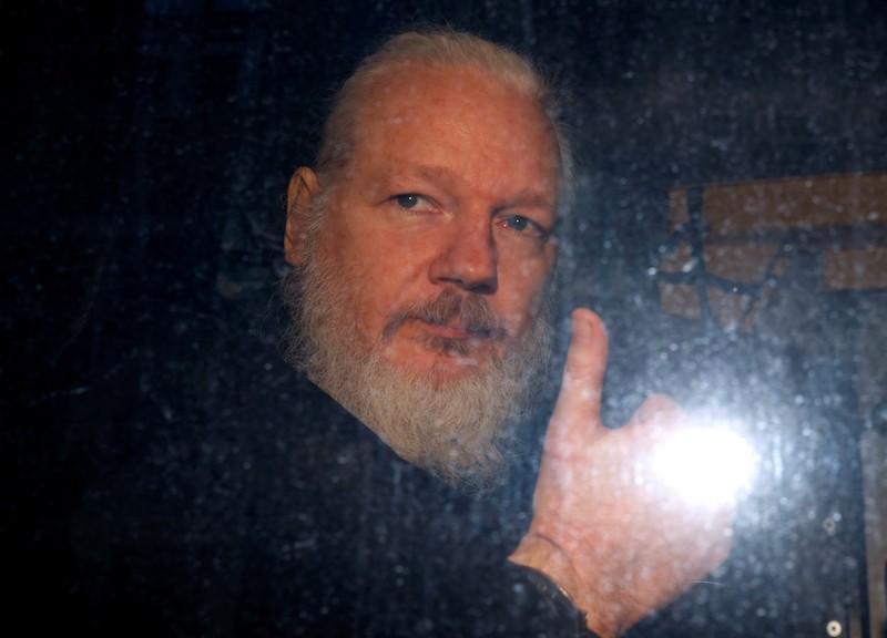 FILE PHOTO: WikiLeaks founder Julian Assange is seen as he leaves a police station in London