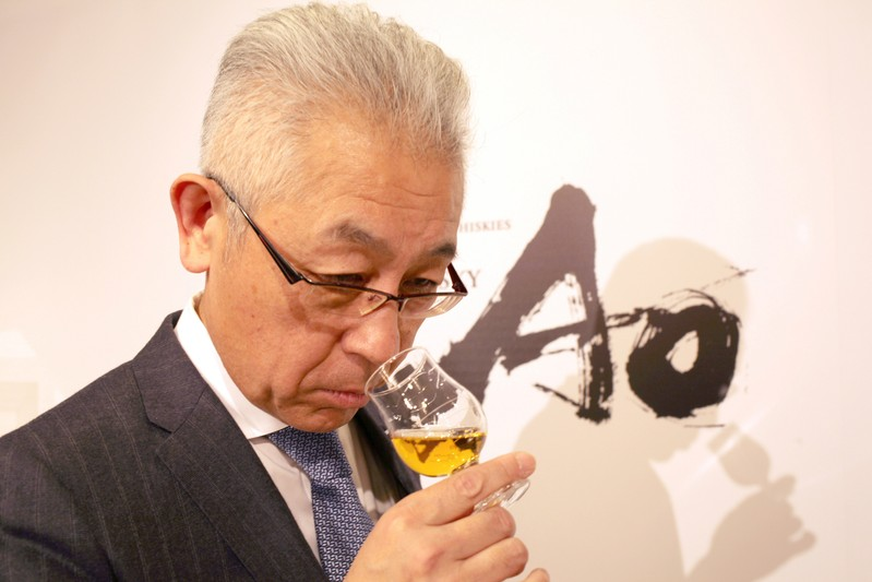 Suntory's chief blender Shinji Fukuyo smells Ao, Suntory's high-end world whisky, during its promotional event in Tokyo